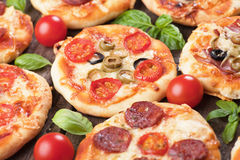Mini pizzas. Mini margarita pizzas with cherry tomato, cheese and olives Stock Images