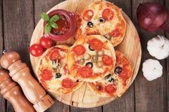 Mini pizzas. Mini margherita pizzas with cheese, olive and tomato Royalty Free Stock Photos