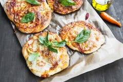 Mini Pizzas with Mozzarella, Cheese, Tomato Sauce and Fresh Basi Royalty Free Stock Photography
