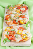 Mini pizzas with mozzarella and cherry tomatoes Royalty Free Stock Photography