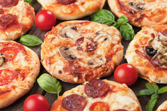 Mini pizzas. With mushrooms, salami, cheese and tomato Royalty Free Stock Photos