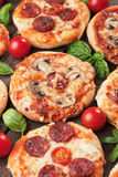 Mini pizzas. With mushrooms, salami, cheese and tomato Royalty Free Stock Image