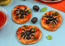 Mini pizzas with olives in shape of spider Royalty Free Stock Photography