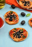 Mini pizzas with olives in shape of spider Royalty Free Stock Photo