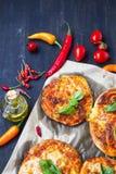 Mini pizzas snacks with cheese, mozzarella,spices and basil leav Stock Photo