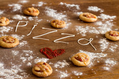 Free Mini Pizzas With Sausage And Cheese On Wood Table Royalty Free Stock Image - 64929566