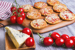 Mini pizzas on a wooden table Royalty Free Stock Image
