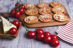 Mini pizzas on a wooden table Royalty Free Stock Photo