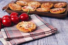 Mini pizzas on a wooden table Stock Photo