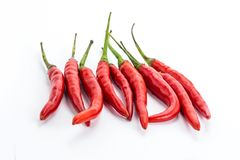 Mini pods of red chili peppers hot additive to meat and chicken giving flavor to a group of vegetables on a white background stock photo