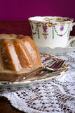 Mini Pound Cake - Almond Lemon Drizzle, Purple Background Stock Images