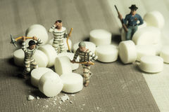 Mini prisoners people. And drugs Stock Photos