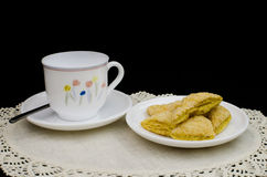 Mini puff with a white cup. On white fabric Royalty Free Stock Image