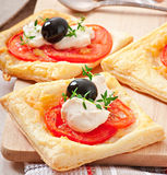 Mini puffs with tomatoes Stock Photo