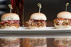 Mini Pulled Pork Sandwiches. Miniature pulled pork sandwiches on a plate served in a restaurant Stock Photography
