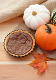 Mini pumpkin pie with fall gourds Royalty Free Stock Photos