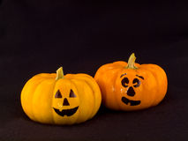 Mini Pumpkins with Funny Faces with a Black Cloth Stock Photography