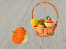 Mini pumpkins. Small ornamental pumpkins and squash in basket on wooden background royalty free stock photo