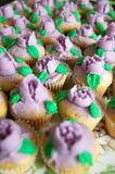 Mini Purple Floral Icing Cupcakes imagen de archivo