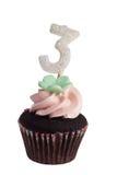 Mini queque com vela do aniversário Fotos de Stock