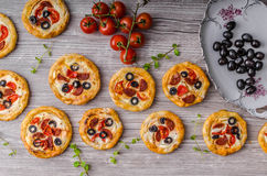 Mini quiche with sausage. And cheddar cheese, tasty and delicious Royalty Free Stock Images