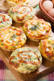 Mini quiche with spinach and vegetables. Mini Quiche Lorraine with spinach and vegetables Royalty Free Stock Image