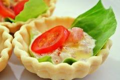 Mini quiche of tuna and vegetables. Stock Image