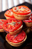 Mini quiches with cheese and tomato Stock Photography