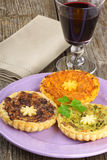 Mini quiches and red wine Royalty Free Stock Images