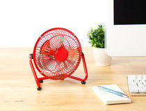 Mini red fan isolated on the desk  Stock Photos