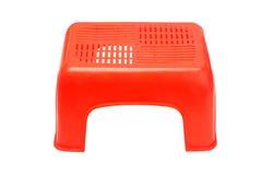 Mini rode plastic kruk Royalty-vrije Stock Afbeeldingen