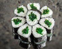 Mini roll with chuka. Over concrete background Stock Image