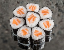 Mini roll with salmon. Over concrete background Stock Photos