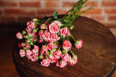 Mini roses  on vintage wooden surface Stock Photo