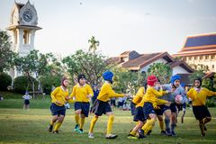 Mini Rugby match with boys player. Mini Rugby match, Vajiravudh College, Bangkok, Thailand - November 2018 : Mini Rugby of age 10-12 years with boys player stock photo
