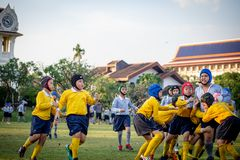 Mini Rugby match with boys player. Mini Rugby match, Vajiravudh College, Bangkok, Thailand - November 2018 : Mini Rugby of age 10-12 years with boys player stock photography