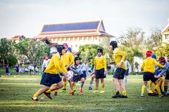 Mini Rugby match with boys player. Mini Rugby match, Vajiravudh College, Bangkok, Thailand - November 2018 : Mini Rugby of age 10-12 years with boys player royalty free stock images