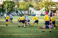 Mini Rugby match with boys player. Mini Rugby match, Vajiravudh College, Bangkok, Thailand - November 2018 : Mini Rugby of age 10-12 years with boys player royalty free stock photography