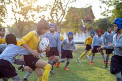 Mini Rugby match with boys player. Mini Rugby match, Vajiravudh College, Bangkok, Thailand - November 2018 : Mini Rugby of age 10-12 years with boys player royalty free stock photos