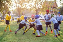 Mini Rugby match with boys player. Mini Rugby match, Vajiravudh College, Bangkok, Thailand - November 2018 : Mini Rugby of age 10-12 years with boys player royalty free stock image