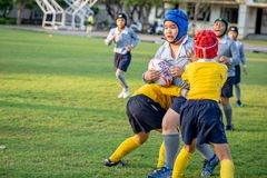 Mini Rugby match with boys player. Mini Rugby match, Vajiravudh College, Bangkok, Thailand - November 2018 : Mini Rugby of age 10-12 years with boys player royalty free stock photo