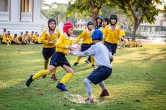 Mini Rugby match with boys player. Mini Rugby match, Vajiravudh College, Bangkok, Thailand - November 2018 : Mini Rugby of age 10-12 years with boys player stock images