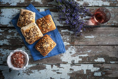 Mini rustic bread with himalayan salt and rose wine on a old table Stock Photography