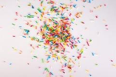 Mini- sötsakstänk som isoleras på vit bakgrund med prövkopian, smsar arkivfoto