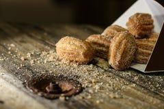 Mini- sött mjölkar churros Arkivbild