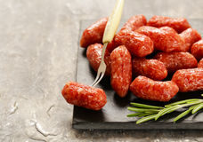 Mini salami sausages on wooden table Royalty Free Stock Photography