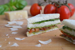Mini sandwich with parma ham. Tomatoes, pesto and rocket salad Royalty Free Stock Images