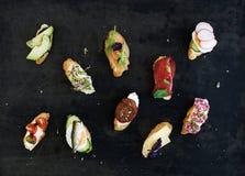 Mini sandwich set. Variety of small sandwiches on Stock Photo