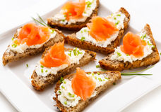 Mini sandwiches. Bread with cream cheese and smoked salmon Royalty Free Stock Photography