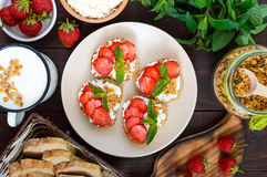 Mini sandwiches with cottage cheese, fresh strawberries, decorated with mint leaves Royalty Free Stock Photography